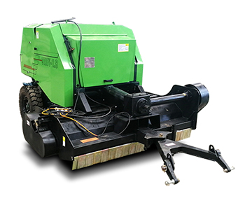 Round baler with cutter